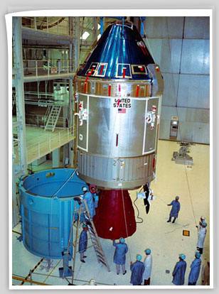 Interior view of the Kennedy Space Center's (KSC) Manned Spacecraft Operations Building showing Apollo Spacecraft 107 Command and Service Modules (CSM) being moved from work stand 134 for mating to Spacecraft Lunar Module Adapter (SLA) 14.