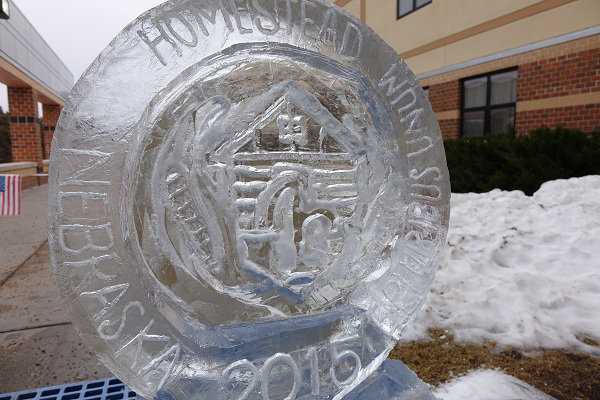 The finished ice sculpture sits outside the entrance to Beatrice High School