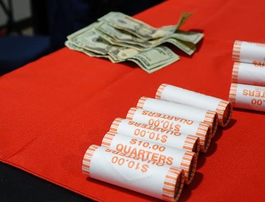 Rolls of Kisatchie National Forest quarters being exchanged after the event.