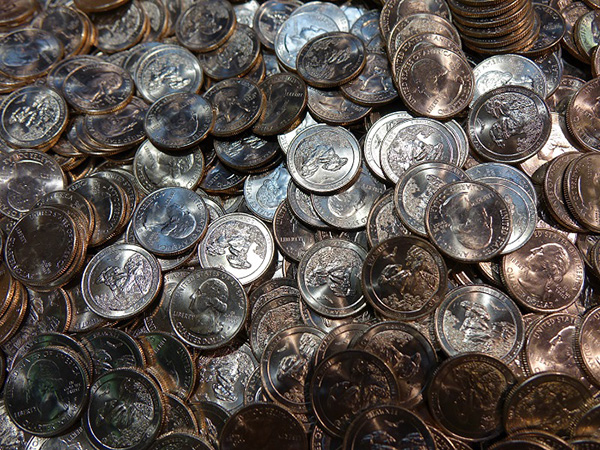 A pile of Shawnee National Forest quarters following the ceremonial coin pour.