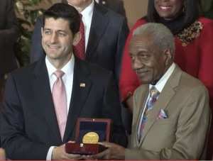 The Reverend F.D. Reese accepts the Congressional Gold Medal from Speaker Paul Ryan.