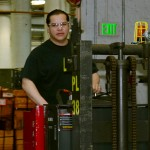 David Chavez operates a fork lift at the Denver Mint.