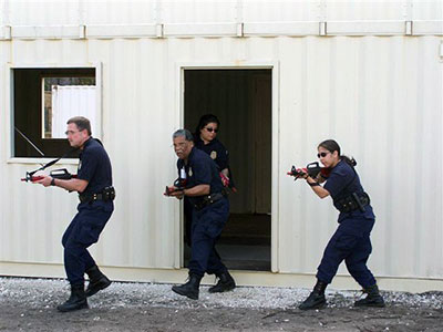 Mint Police officers (left to right) James Downey, Tyrone Savage, Anna Villafrank and Anna Lopez engage in Basic Tactics Training during United States Mint Police In-Service training at the Federal Law Enforcement Training Center in Glynco, Georgia.