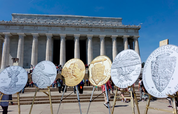 NPS coin designs displayed in front of the Lincoln Memorial.