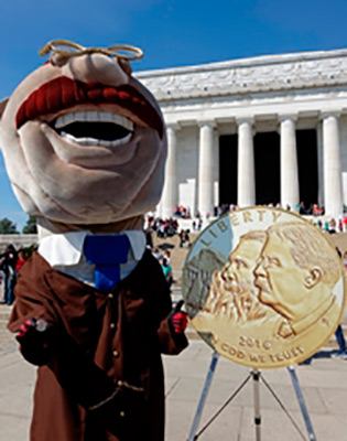 Washington Nationals Running President Teddy Roosevelt holds a NPS commemorative coin.