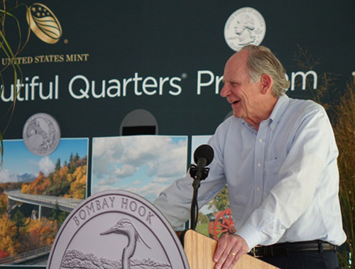 Former Governor and U.S. Representative Mike Castle speaks to the crowd at the Bombay Hook National Wildlife Refuge quarter launch on Sept. 18, 2015, in Smyrna, DE. U.S. Mint photo by Sharon McPike.