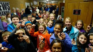 Excited fourth graders proudly hold their new Saratoga National Historical Park quarters after the ceremonial launch.