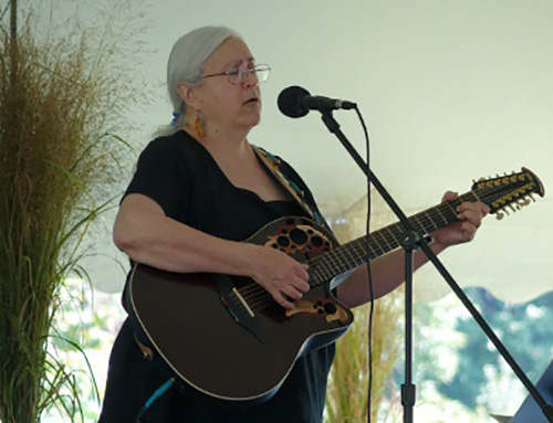 Singer/songwriter Leilani Wall entertains the crowd before the Sept. 18, 2015, ceremony to launch the Bombay Hook National Wildlife Refuge quarter in Smyrna, DE. U.S. Mint photo by Sharon McPike.