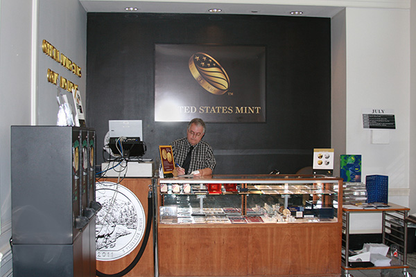 Retail Sales Team member Russell Snyder mans the sales counter in this photo taken in 2011.
