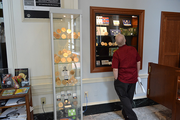 A customer checks out products showcased in one of the new display cases.