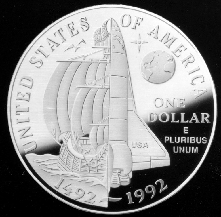 The 1992 Christopher Columbus Quincentenary Commemorative Silver Dollar features a space shuttle.