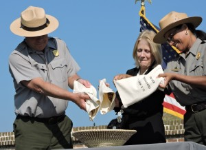 Superintendent Tim Stone, United States Mint Chief Counsel Jean Gentry, and Regional Deputy Director Sherri Fields participate in the ceremonial coin pour.