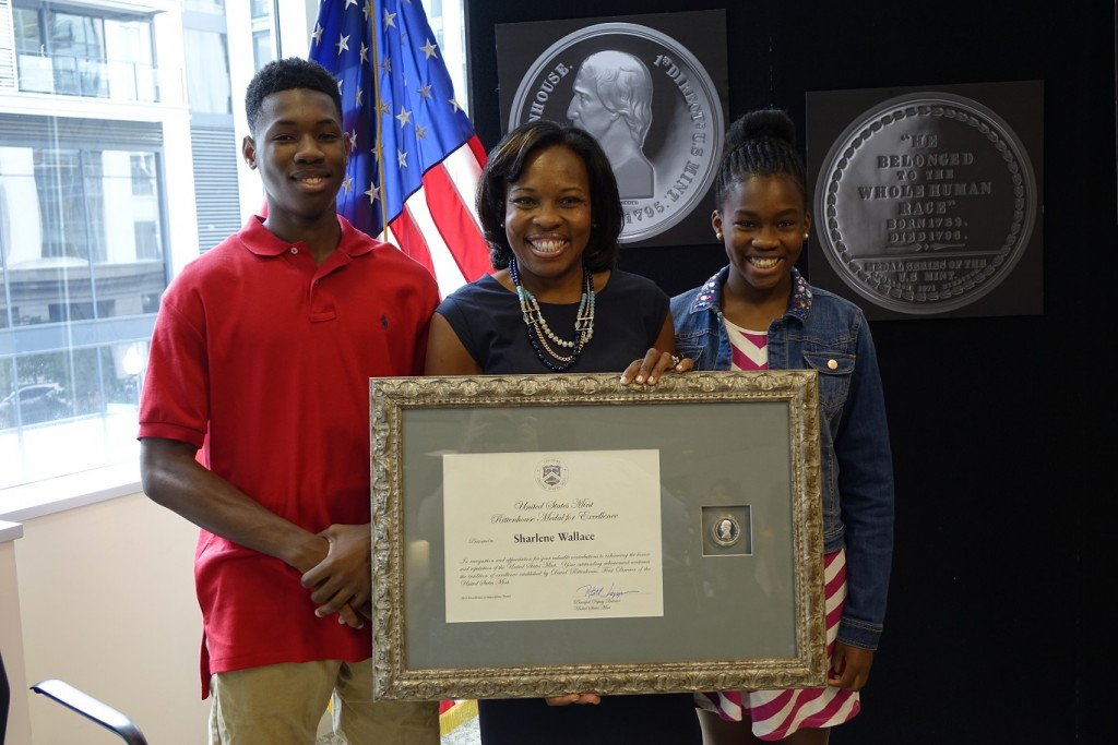 Sharlene Wallace receiving the 2014 Rittenhouse Award for Excellence. Also featured are her children Joshua and Jessica Wallace.