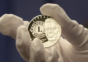 The coin's obverse features a portrait of founder Melvin Jones paired with the Lions Clubs International logo.