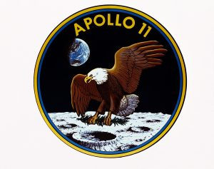 Apollo 11 mission patch with eagle landing on the moon