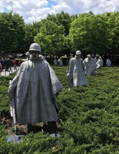 Stone statues of soldiers at the Korean War Veterans Memorial