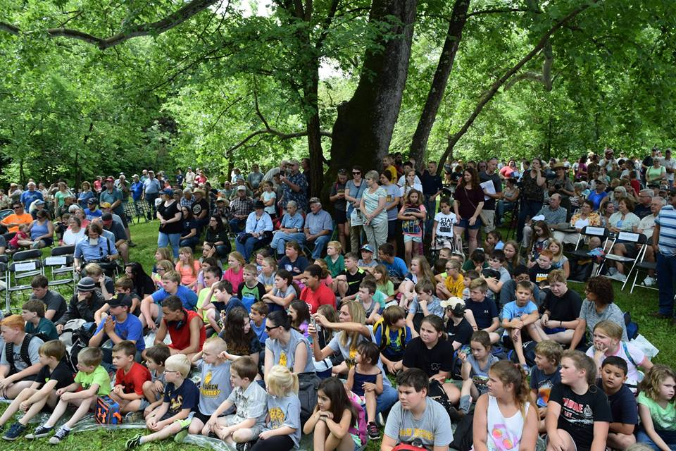 A crowd of more than 1,800 people witnesses the June 5, 2017, ceremonial launch of the Ozark National Scenic Riverways quarter in Eminence, MO.