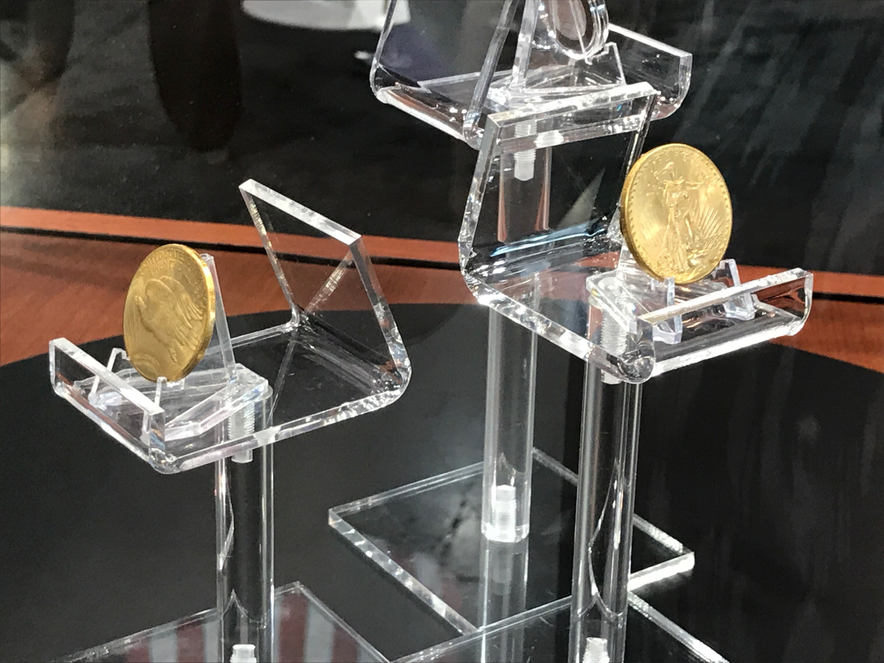 Two 1933 Double Eagle coins on display. U.S. Mint photo by Debbie Dawson