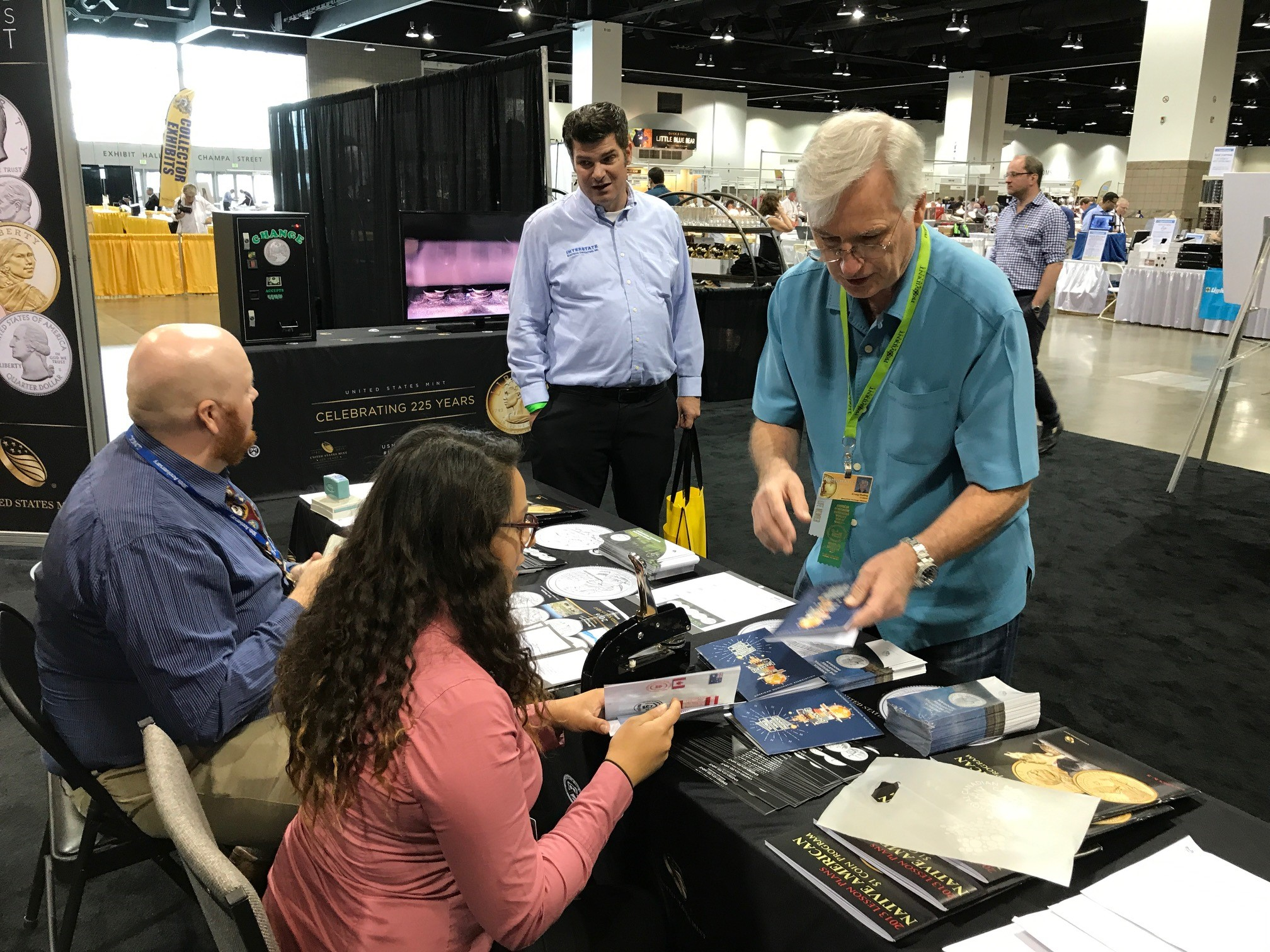 An attendee gets his World Mints Passport stamped by the U.S. Mint. U.S. Mint photo by Debbie Dawson.