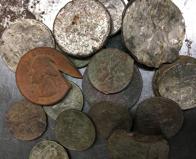 Pile of mutilated coins.