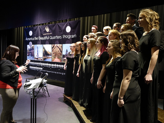 The Munising High School Concert Choir sings the National Anthem.