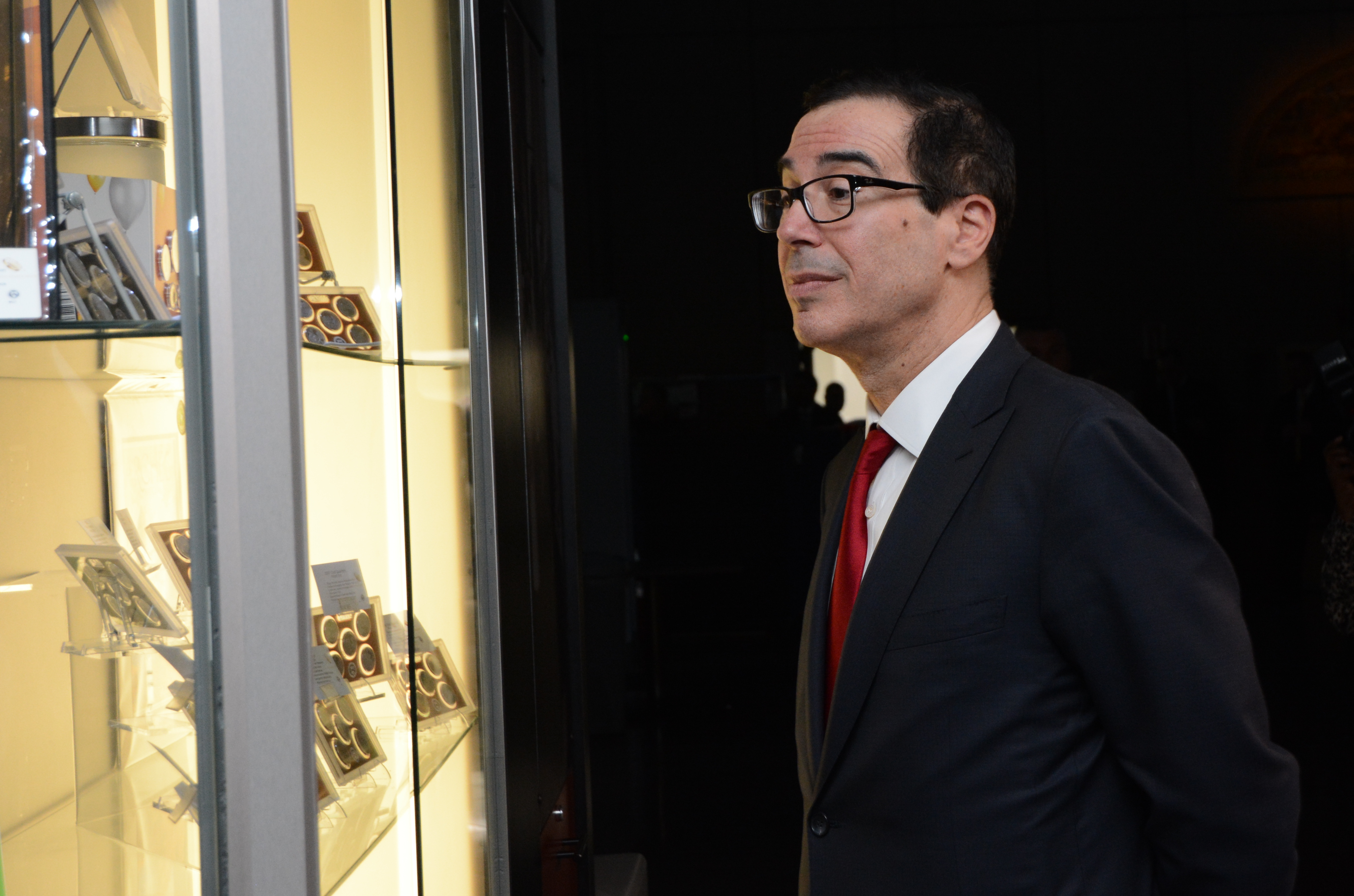 Treasury Secretary Steven Mnuchin looks at numismatic products at the gift shop following his visit of the U.S. Mint facility in Philadelphia. U.S. Mint photo by Jill Westeyn.