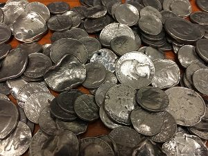 pile of mutilated coins