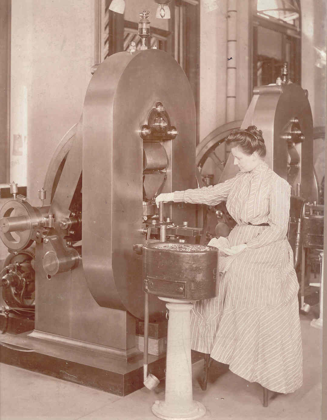 Coin Press at Philadelphia Mint, 1903 – Once steam power was introduced at the Mint in the 1830s, women moved into coin production jobs.