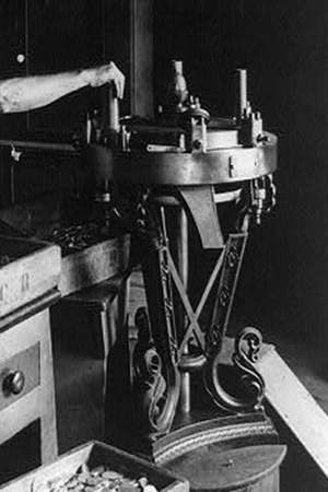 Milling Machine at New Orleans Mint, 1897 – In the 1860s women were first hired to operate the milling machines, which created a raised rim on the coins.