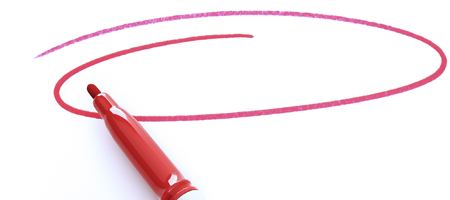 red pen circling white paper