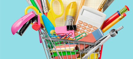 small shopping cart filled with school supplies