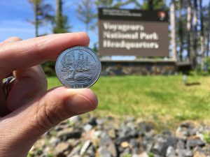 Voyageurs National Park Quarter with national park sign in the background