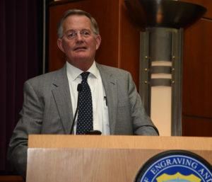 man standing behind a podium