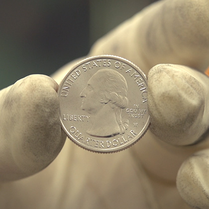 hand holding the 2019 America the Beautiful Quarters obverse with W mint mark