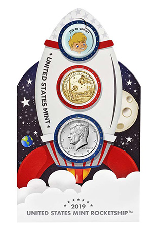 cardboard rocketship with Kennedy half dollar and 2019 Native American dollar inset