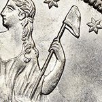 close up of liberty cap on a pole on the seated liberty half dollar obverse