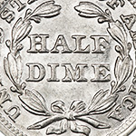 close up view of a wreath on the seated liberty half dime reverse