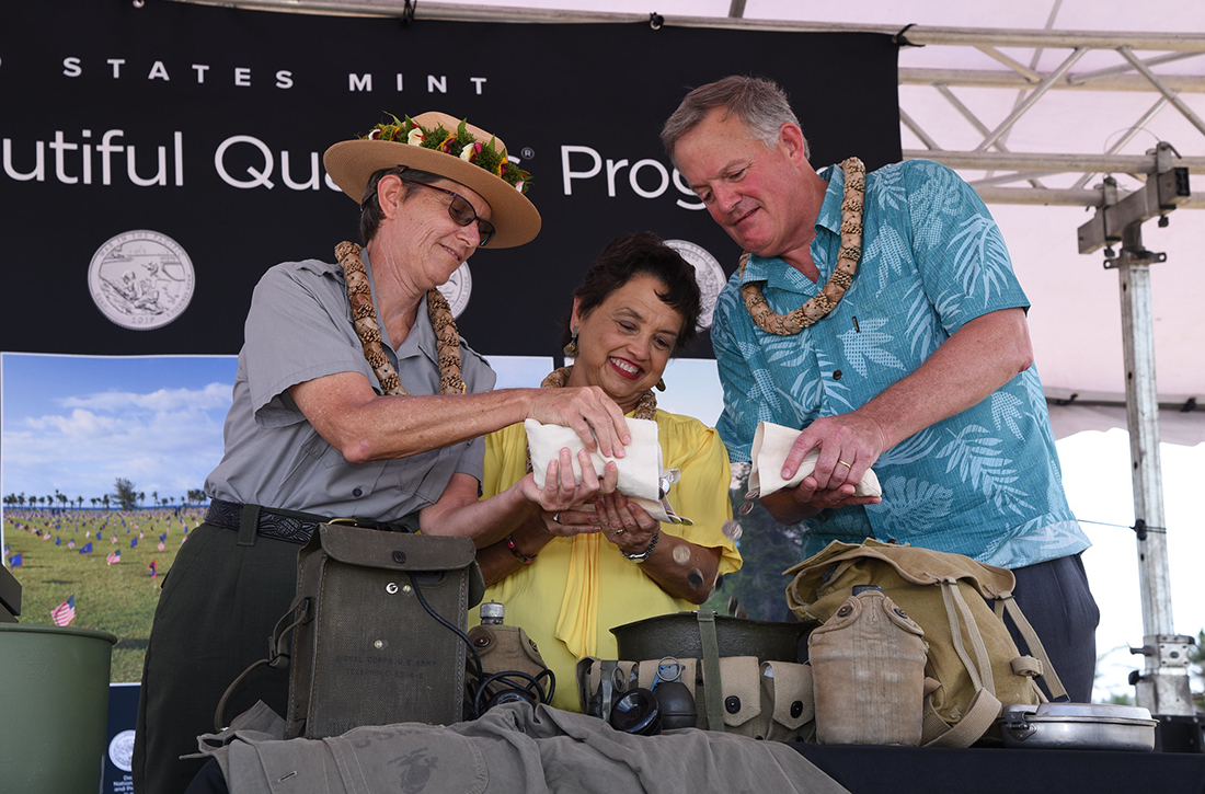 Director David Ryder, Governor Lourdes Leon Guerrero, and Superintendent Barbara Alberti, participate in the War in the Pacific National Historical Park coin pour.
