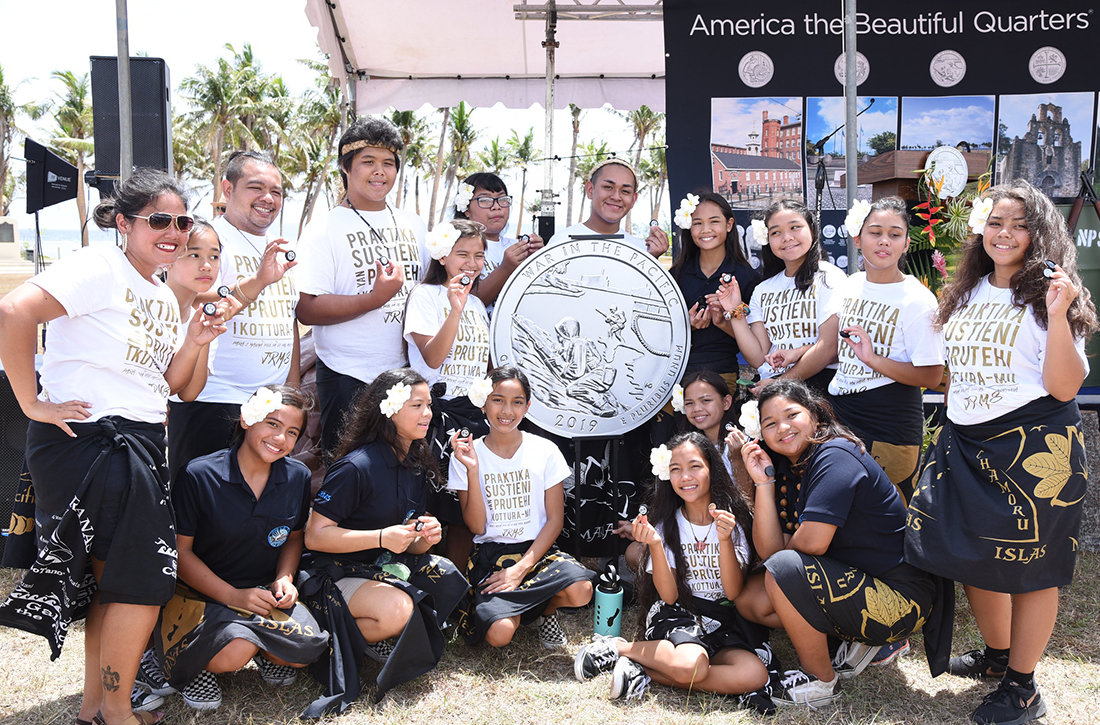 Students from the Jose Rios Middle School Cultural Club Guma Kinalamten I Taotao hold War in the Pacific National Historical Park quarters.