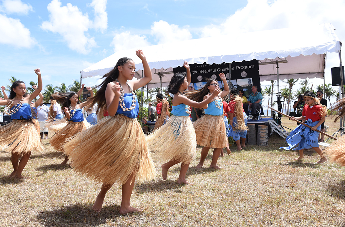 Students from Oceanview Middle School's Guma' Nina'en Åcho' Latte perform during the War in the Pacific National Historical Park quarter launch.