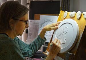 U.S. Mint medallic artist sculpts a clay coin model