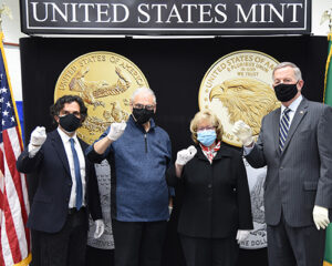 U.S. Mint Director David Ryder and other U.S. Mint staff hold American Eagle coins
